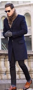 men's fur scarf, navy jacket, print socks, and loafers