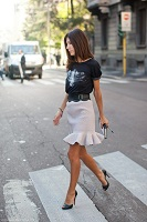 black graphic tshirt with cream skirt