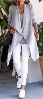 Foolproof tips trendy airport style-white pants, long gray over-sized cardigan