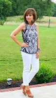 white jeans, navy and white print tank top and high heel sandals