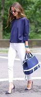 white jeans, three quarter length navy top and navy handbag