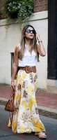 yellow floral maxi dress and white sleeveless button down shirt belted