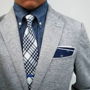 Men's gray knit suit with chambray button down shirt
