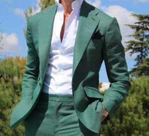 Men's green suit with white button down shirt