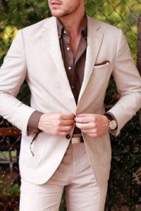 Men's khaki suit with brown button down shirt