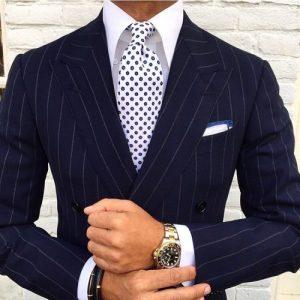 Men's navy pin stripe suit, print tie