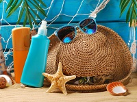 Beach bag essentials, beach bag sunscreen on the beach