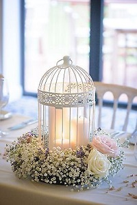 diner en blanc table decor, white birdcage with flowers