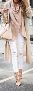 Fall layering, white distressed jeans, long taupe vest, sweater, fall fashion