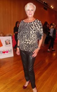 How to Wear Leather Pants, leather pants and animal print top for women over 40-min