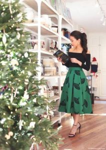 Holiday attire, what to wear to work party green print midi skirt and black off the shoulder top