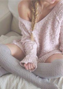 Women's holiday loungewear, knit pink sweater dress and socks