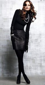 Women's monochromatic black outfit with gray and black leopard skirt