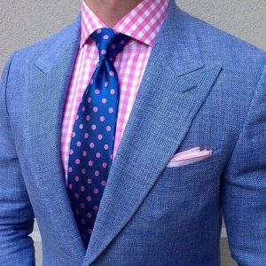 men's blue tweed suit with pink checked button down shirt and blue pink polka dot tie