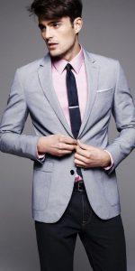 men's dark denim, light gray blazer and pale pink button down shirt with navy tie