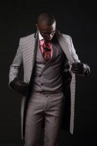 men's gray suit with pink button down shirt and black and white long coat