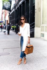 spring outfits in winter cuffed jeans and long white blazer with sandal heels-min
