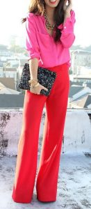 spring color trends 2017, pink button down shirt and red pants women's