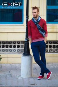 spring color trends 2017, men's blue pants with red sweater and blue scarf