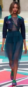 Burberry Prosum jean jacket with tulle tiered skirt and colored sneakers