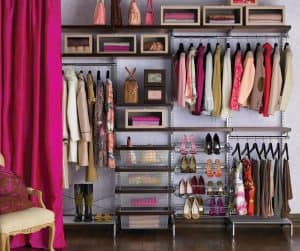 closet organized by color and type of clothing