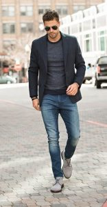 men's business casual shoes, navy blazer, khaki jeans, and camel lace up rubber sole shoes