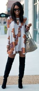 floral long sleeve minidress with black over the knee boots and gray satchel purse