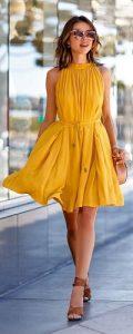 gold sunglasses and mustard sundress
