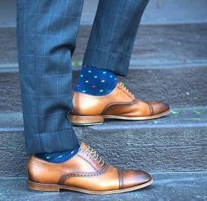 men's gray windowpane suit with light brown shoes and blue polka dot socks, men's spring color sock and shoe combinations