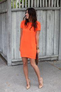 orange sundress and nude high heels