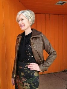 50 and stylish modern looks wearing leather, leather jacket with print skirt