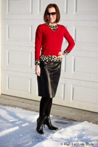 50 and stylish work to evening chic outfit, leather skirt, animal print top, red sweater and shoe booties