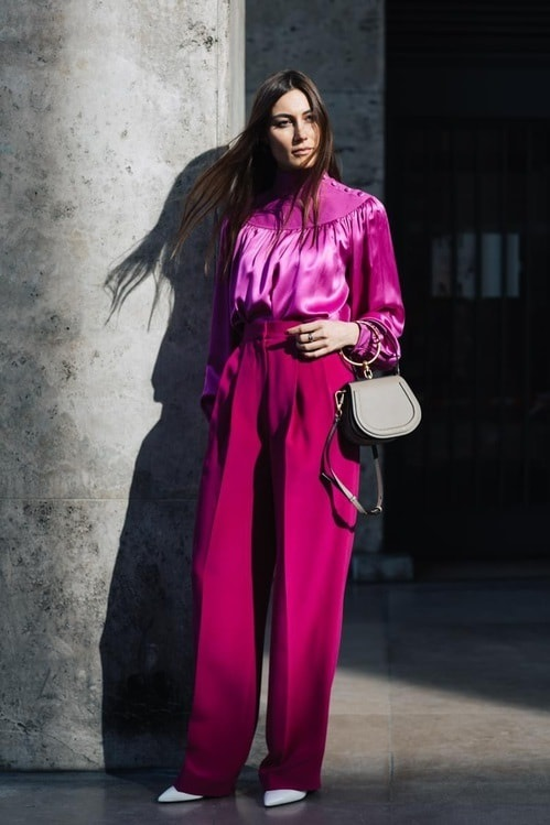 Parisienne style monochromatic outfit, pink blouse and pink trousers