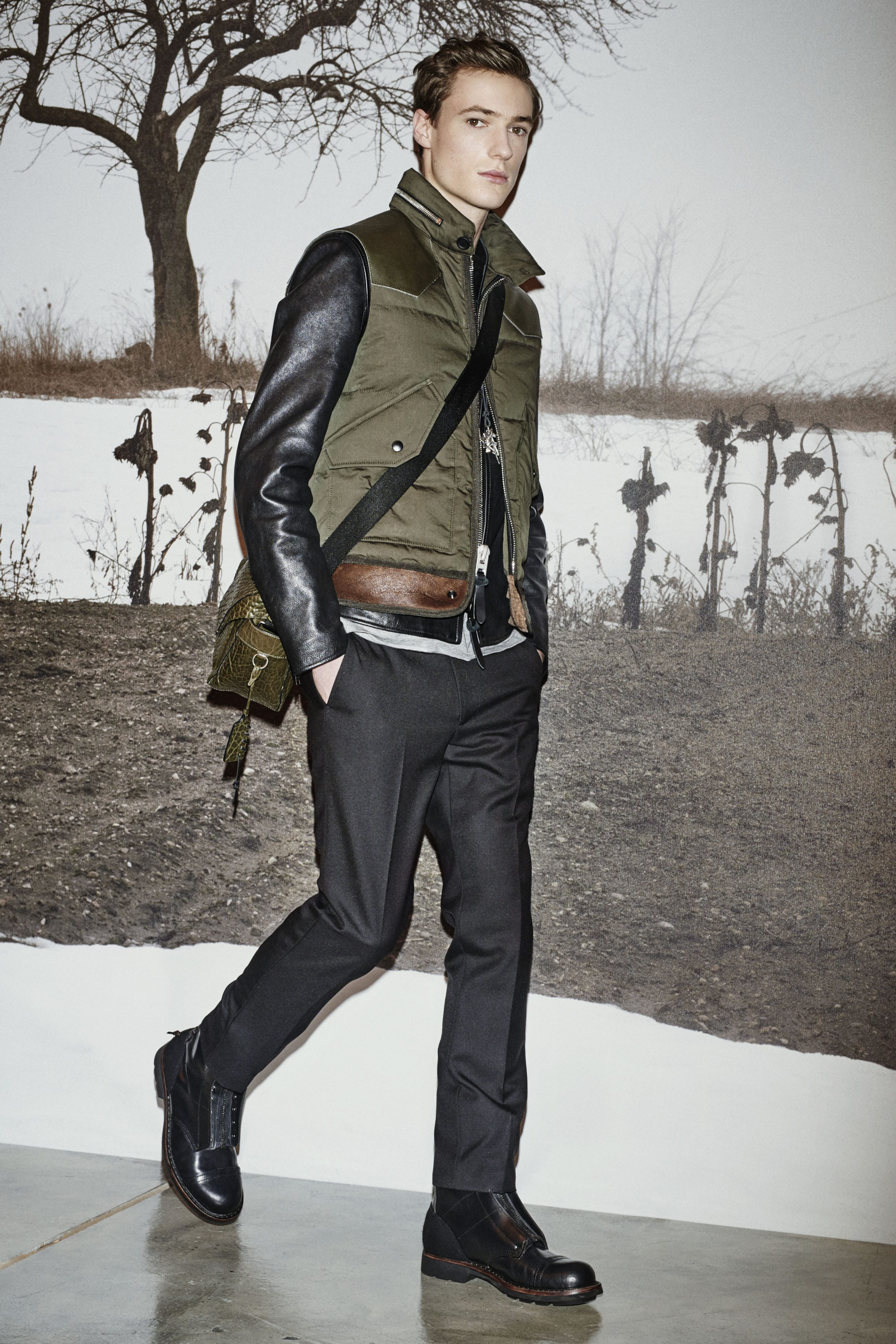 men's night on the town, military down bomber vest, and black leather jeacket with gray trousers