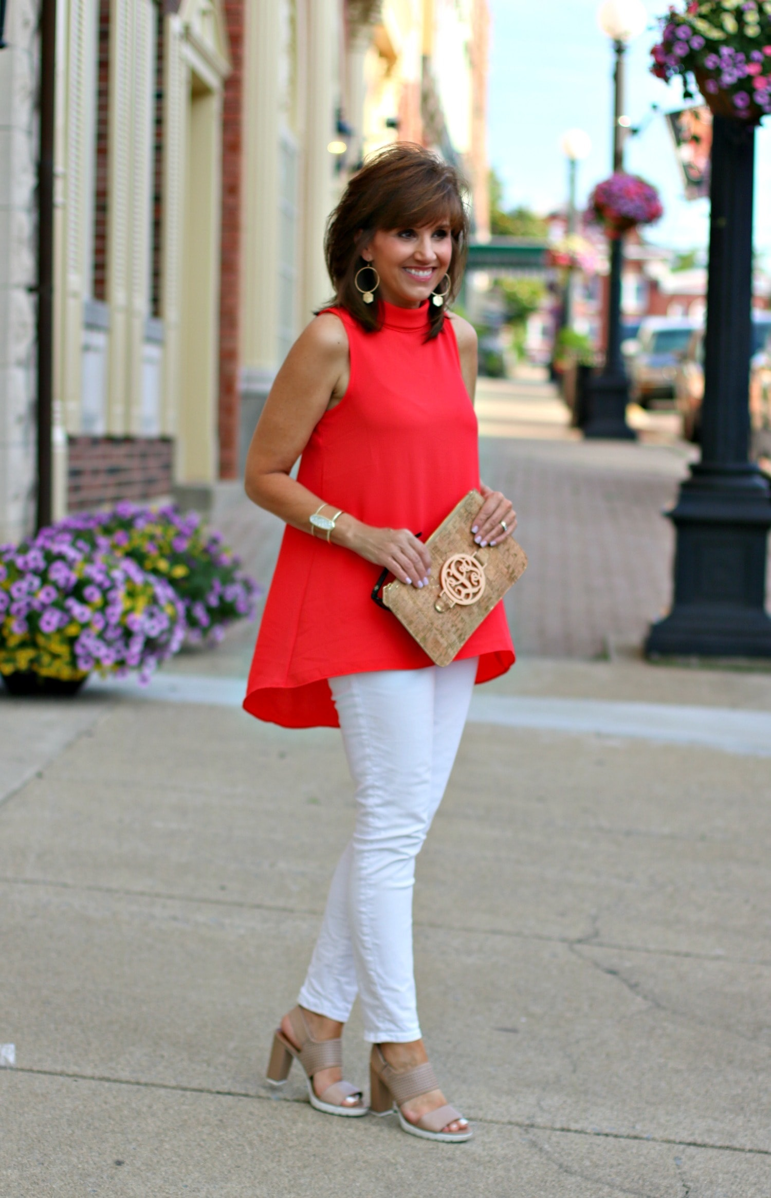 Galentine's Day fashion outfit, white jeans and red top with a clutch and pink sandals
