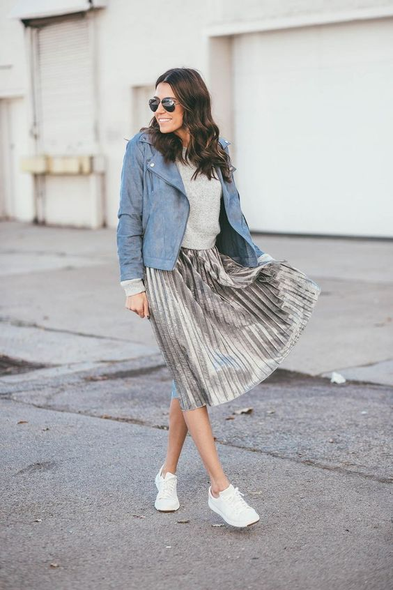 Spring Shoe Trends for women, spring trainers, a metallic midi skirt, trainers, and blue suede moto jacket