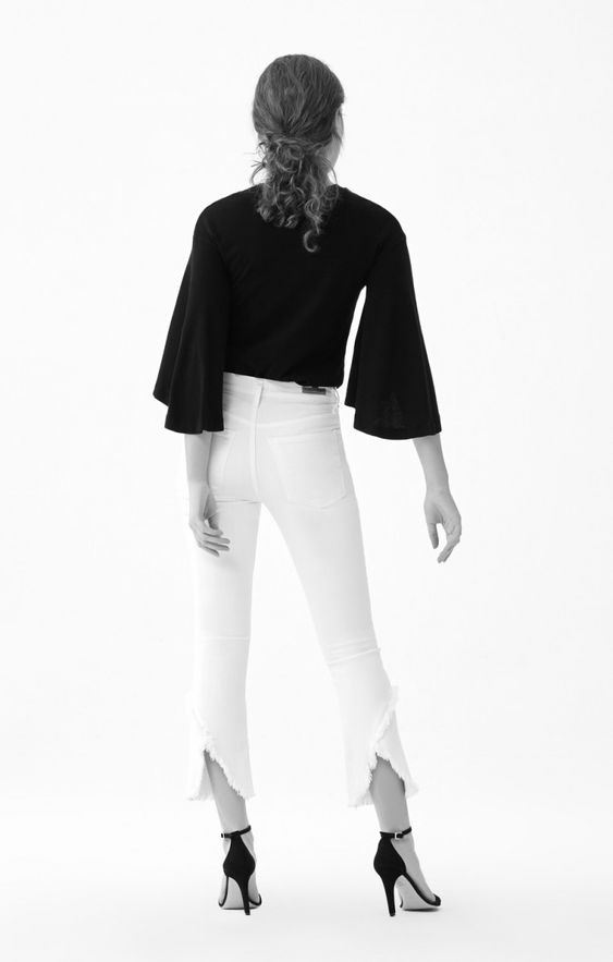spring's white denim trends, tulip hem jeans, white citizens of humanity drew flare fray jeans with black flare blouse