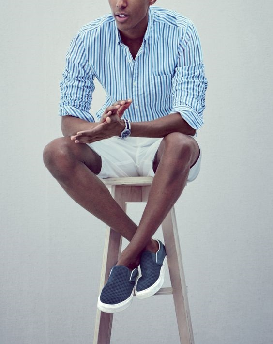 How to Stay Cool and Look Chic this Summer for Men, men's blue slip on sneakers with print button down and shorts