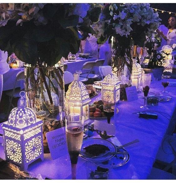 Dîner en Blanc Decor & More, Dîner en Blanc table with white lanterns and large floral vases