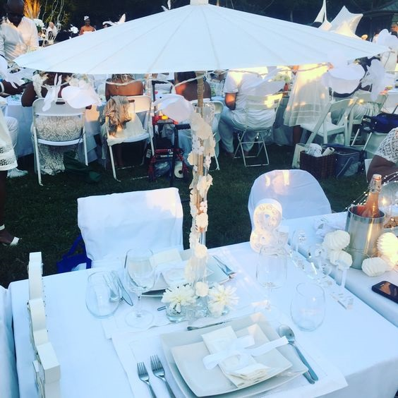 Dîner en Blanc decor, Dîner en Blanc table with white umbrella, flowers and lights