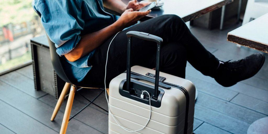 What to Pack for Holiday Travel, carry on suitcase with charging station