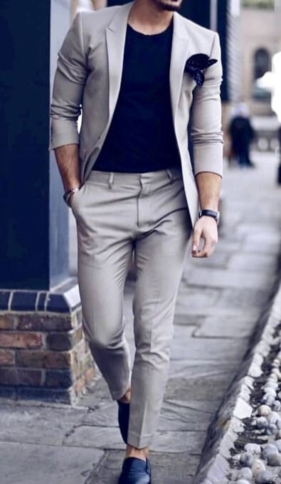 The Style Essentials You Need Men, great fitting suit, men's tan suit with black shirt