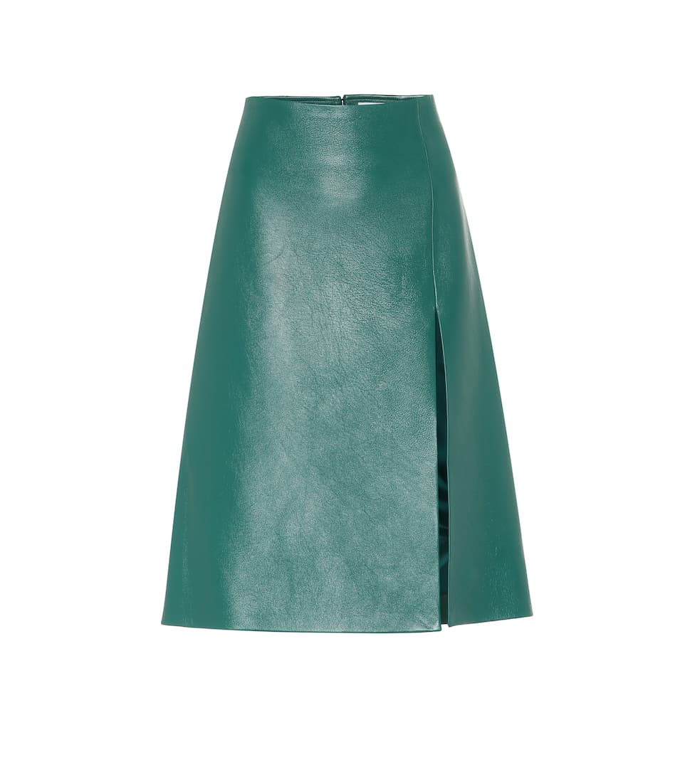 Stylish Looks for Holiday Travel, women's holiday ski lodge outfit, BALENCIAGA green leather midi skirt