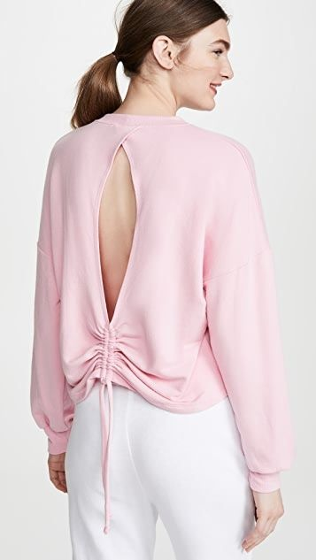 Sequester in Style What to Wear While Working From Home, women's loungewear, Year of Ours lindsey open back sweatshirt in peony pink